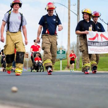 Male firefighters in red high heels