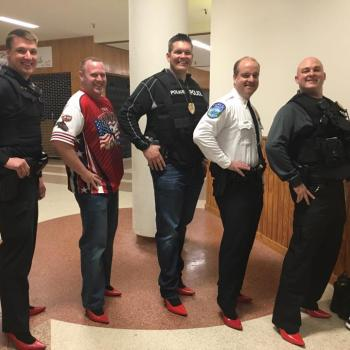 police officers wearing red high heels