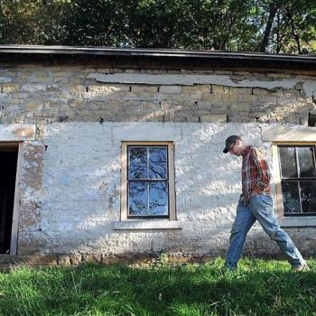 Caleb Wunderlich in front of Stone House
