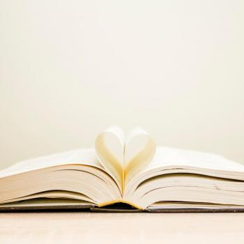 a photo of book pages shaped into a heart