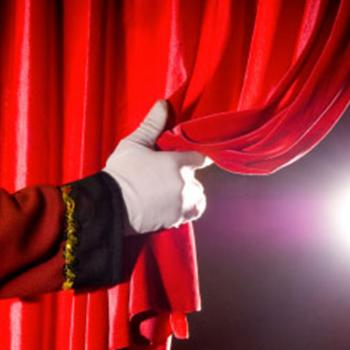 Theater and Film Curtains pulled back for a performance