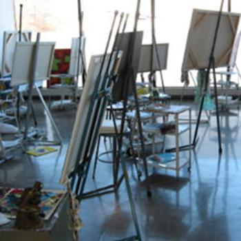 Artists easels in front of a sunny window