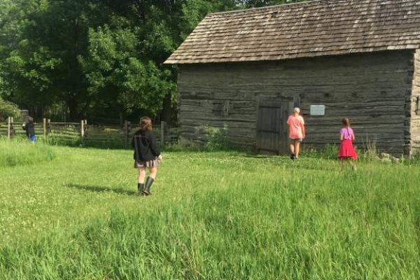 The 1850s farm site with log cabin takes you back in time at Farmamerica