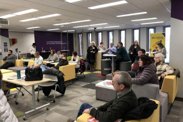 Audience at 1Million Cups Mankato in 2019 Diverse crowd, different ages, genders and backgrounds listening to speaker