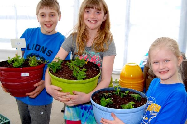 Kids planting annual containers